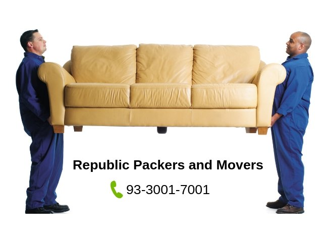 Two guys lifting sofa for relocation